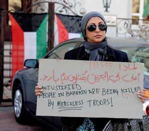 A Shia woman protests outside the Bahraini embassy in Kuwait. Photo courtesy of Ra'ed Qutena/Flickr.