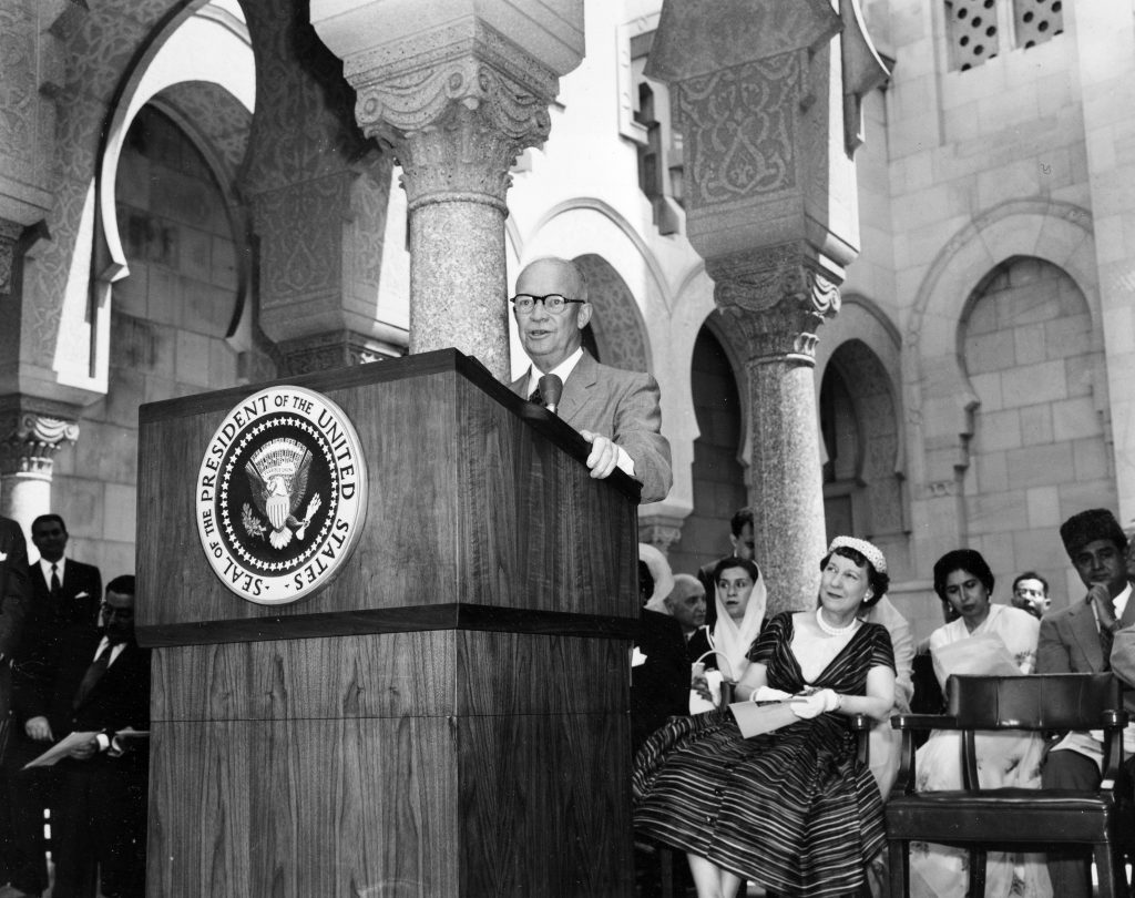 First lady Mamie Doud Eisenhower is seated in the first row as she listens to U.S. President Dwight D. Eisenhower's address to representatives of 15 Muslim nations at the dedication ceremony of the Islamic Center in Washington, on June 28, 1957. (AP Photo)