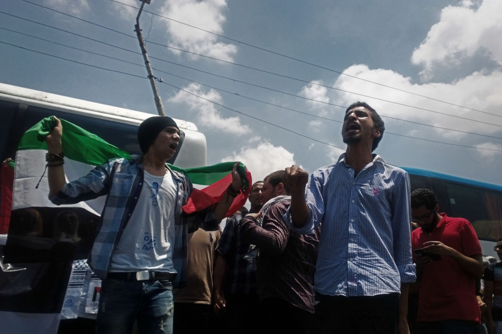 Volunteers chant in solidary with Gaza, at al-Balouza checkpoint.