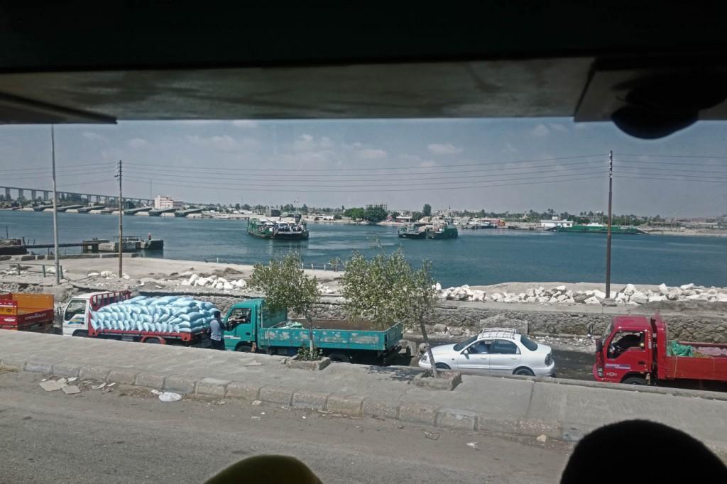 The convoy's buses cross the Suez Canal towards al-Balouza checkpoint.