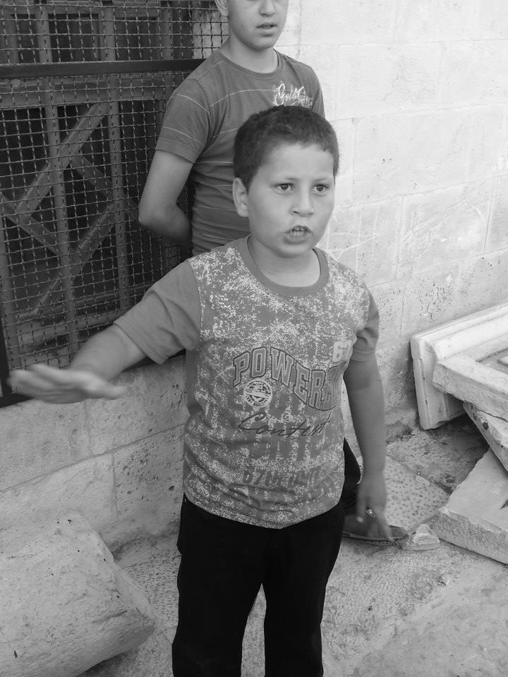 "Antepli says:  This is little  Ishak (11), my good friend.  We became  friends over these visits . He is one of many Palestinian kids who work as ""tour guide"". The pic of Ishak was taken right outside of the gates of Aqsa compound, Haram Al-Sharif.  Copyright Abdullah Antepli/2014"
