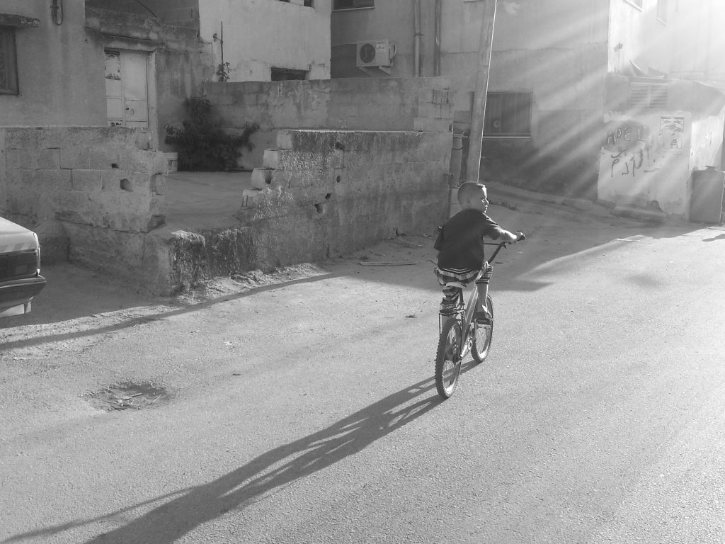 boy on bike west bank jenin