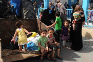 Palestinian families take shelter at an UNRWA school in Gaza City (13 July 2014). Photo: Shareef Sarhan/UNRWA