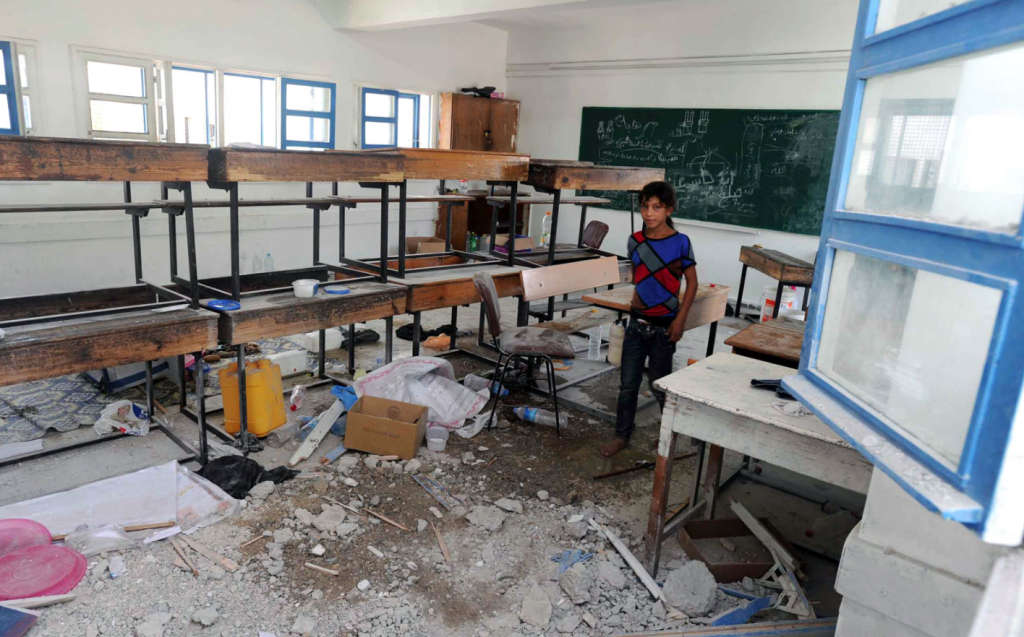 Ninety displaced people, on average, sleep in classrooms like this one that was struck by Israeli artillery shells. © Shareef Sarhan/UNRWA Archives