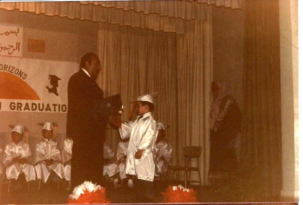 Dr. Hathout presents diplomas to students at the New Horizon School in 1987