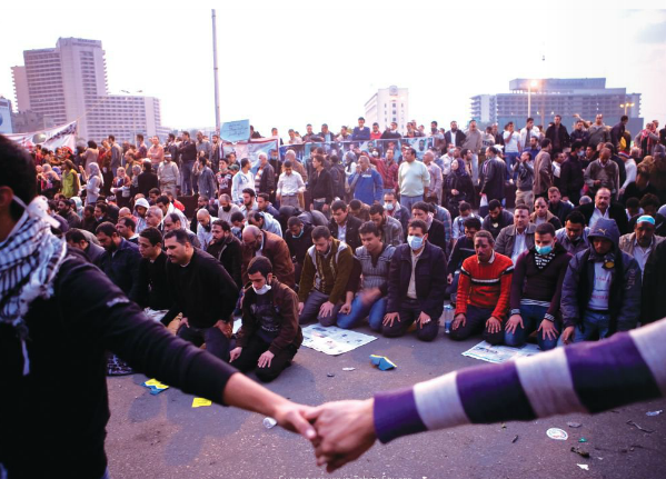 Sunset prayers at Tahrir Square.  photo from flick.com/Hossam el-Hamalawy