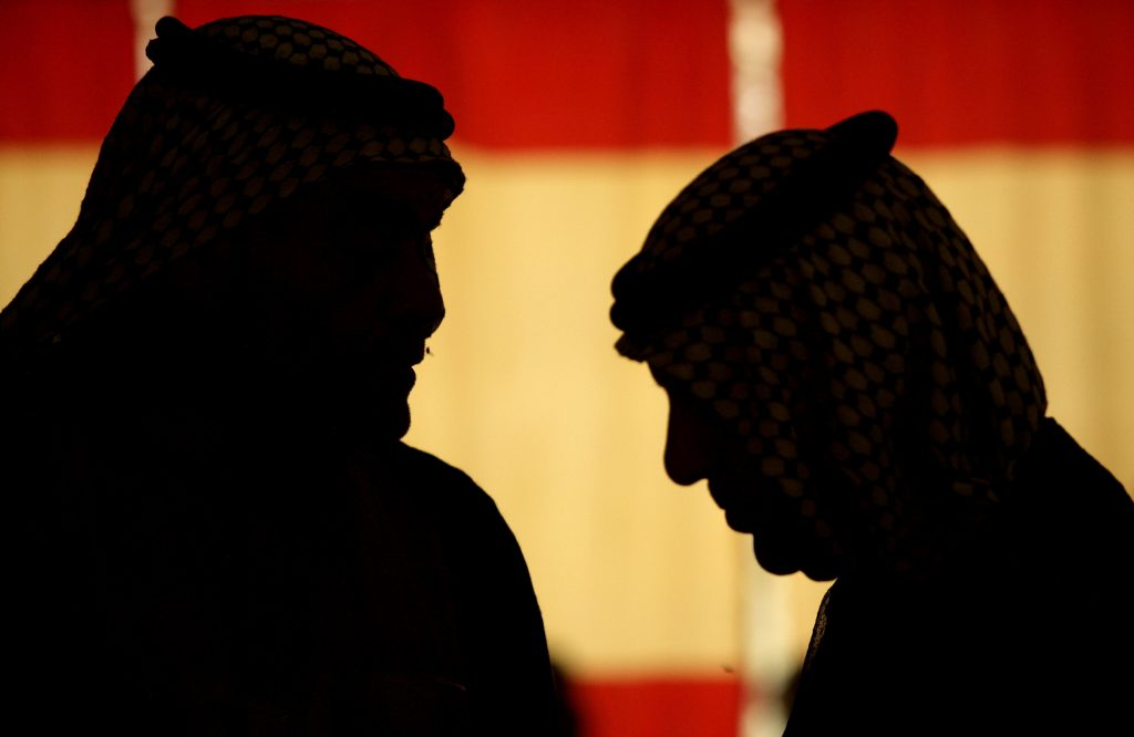 ** FILE ** In this June 26, 2008 file photo, Sheiks from the Shiite Tammimi tribe confer at a reconciliation meeting with the Sunni Jabouri tribe in Muqdadiyah, north of Baghdad. (AP Photo/Maya Alleruzzo)