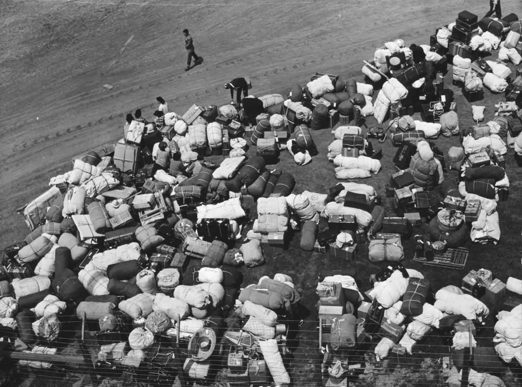 The baggage of Japanese Americans from the west coast, at a makeshift reception center located at a racetrack. Source Wikipedia/CC