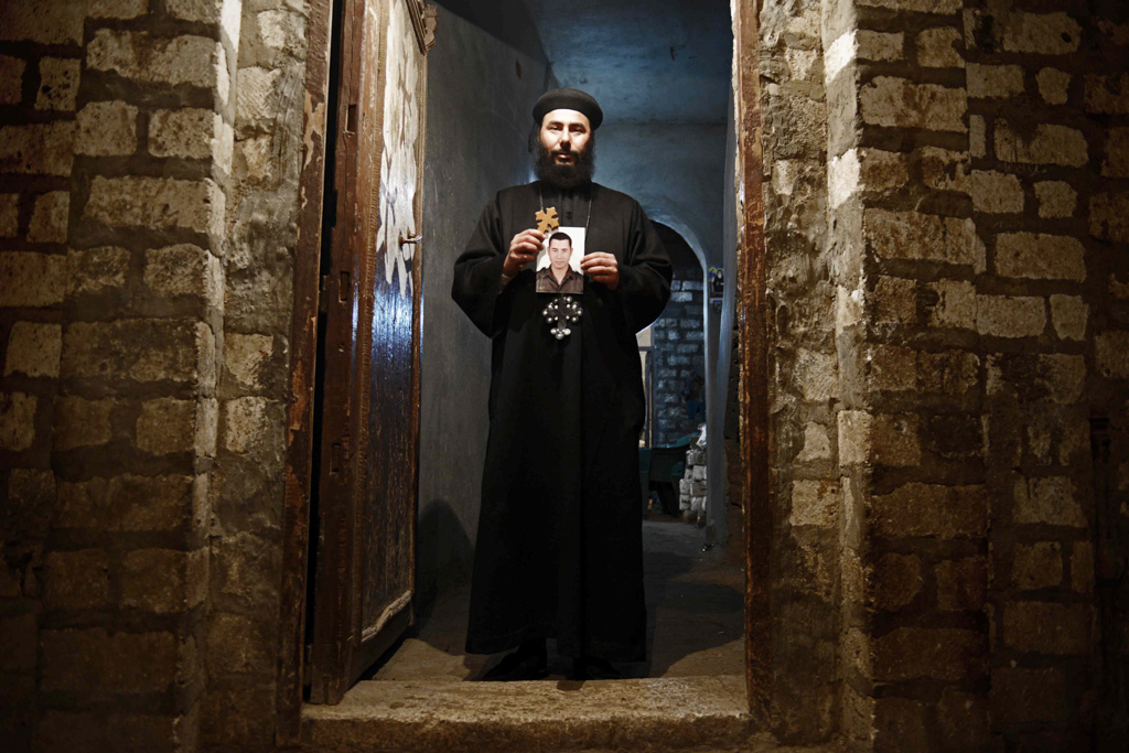"""Bishop Botrous, uncle of slain laborer Mina Fayez, 23. """"Our Orthodox church is a great church. Our church was build by the blood of martyrs. Throughout history, it has always brought heroes and martyrs to the world. I was shocked when I heard the news. But I was definitely happy for my nephew. He's a martyr,"""" said Shehata."""