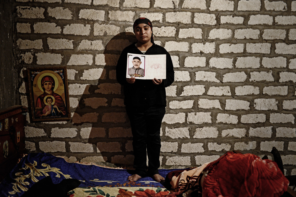 """Fifi, daughter of slain laborer Maged Shehata, 41.  """"My father died like a lion. He did not bow his head down. ISIS has no religion or mercy. I am now from the city of the martyrs. The city of the brave lions. May god forgive the killers. We don't have hatred towards them - this is Christianity. God forgives the sinners, so shall we,"""" said Fifi."""