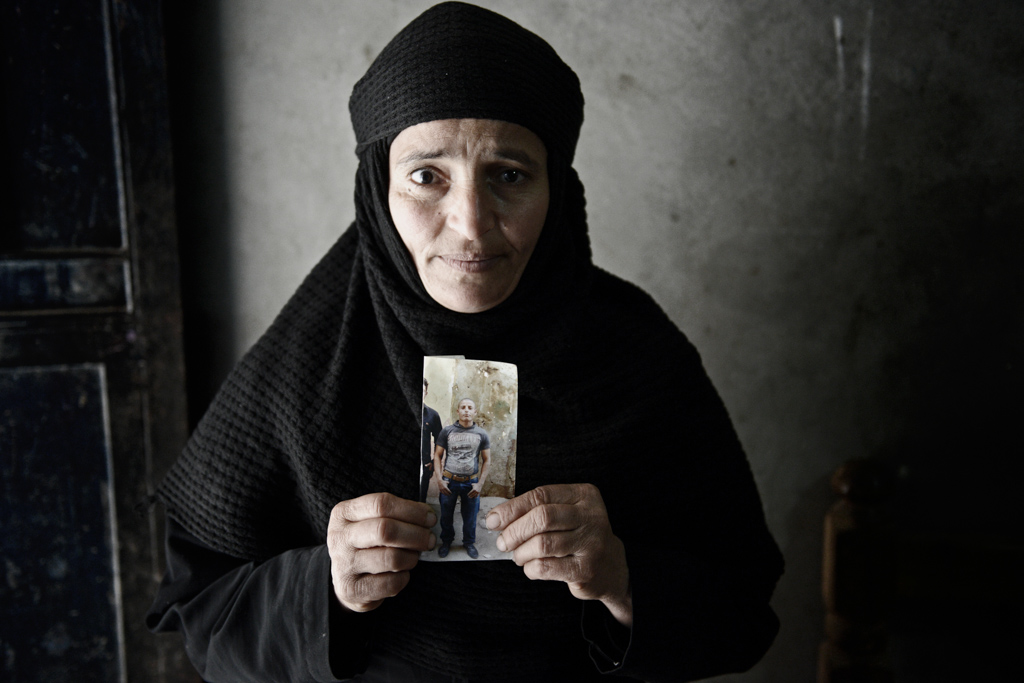 """Mona, mother of slain laborer Kirollos Boushra, 23 """"Kirollos always wanted to be a bishop. He is even better now. He is a martyr. He travelled to Morocco and Libya after he finished his military service in Egypt. He wanted his family to have a better life,"""" said Mona."""