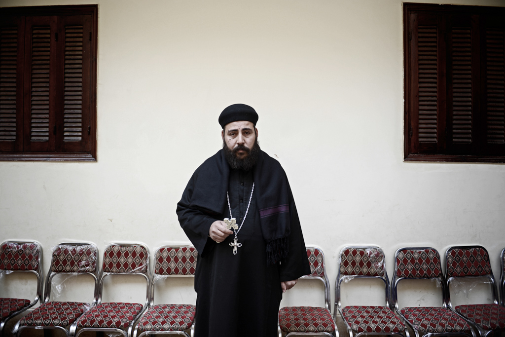 """Bishop Felobous, relative of five slain laborers; uncle of Kirollos Boushra, 23 and cousin of Maged Shehata, 41, Youssef Shokry, 23, Abanoub Atiya, 24 and Hany Abdel-Messih, 32. """"Their leaving is painful. But we are not sad. We are proud of our martyrs. I congratulate ISIS. God is using them to bring martyrs to the world. Everything happens for a reason.  I was very sad when I heard the news of the air strikes lead by the Egyptian military against ISIS. God asked us to even love our enemies,"""" said Felobous."""