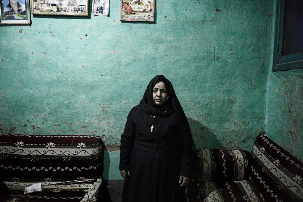 """Tereza, mother of slain laborer Youssef Shoukry, 23 """"Youssef was a farmer and a carpenter. He thought he would be a kind working in Libya. That party happened. He is a kind in heaven,"""" said Tereza."""