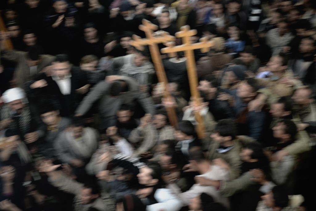 Citizens of Al-Aour village and relatives of slain laborers chant at Al-Aour church.