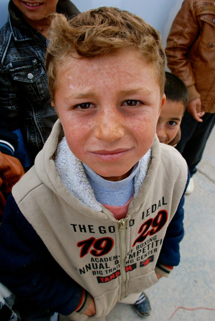 A young Iraqi refugee wandering the streets of Dohuk in Northern Iraq.