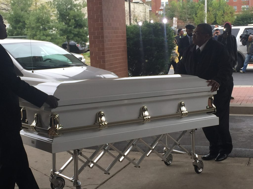 The casket of Freddie Gray arrives at the church and is transported to the hall.