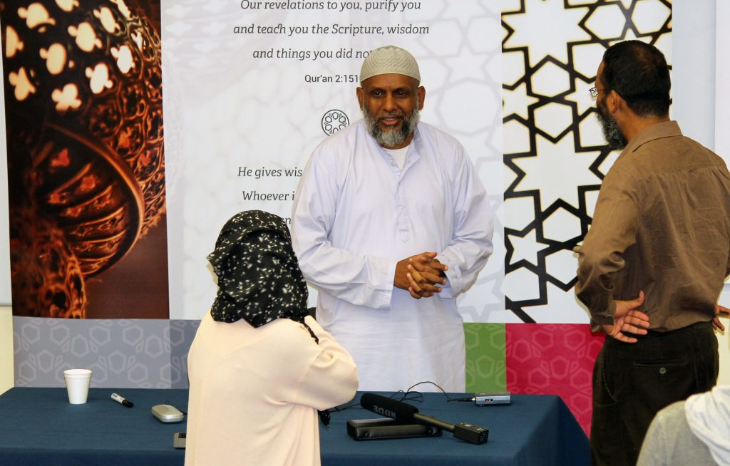 While ultra-conservatives have occasionally frowned on the sheikh taking one-on-one questions from women students at breaks in his lectures, he makes himself readily accessible to all his students. >Photo courtesy of Cambridge Islamic College