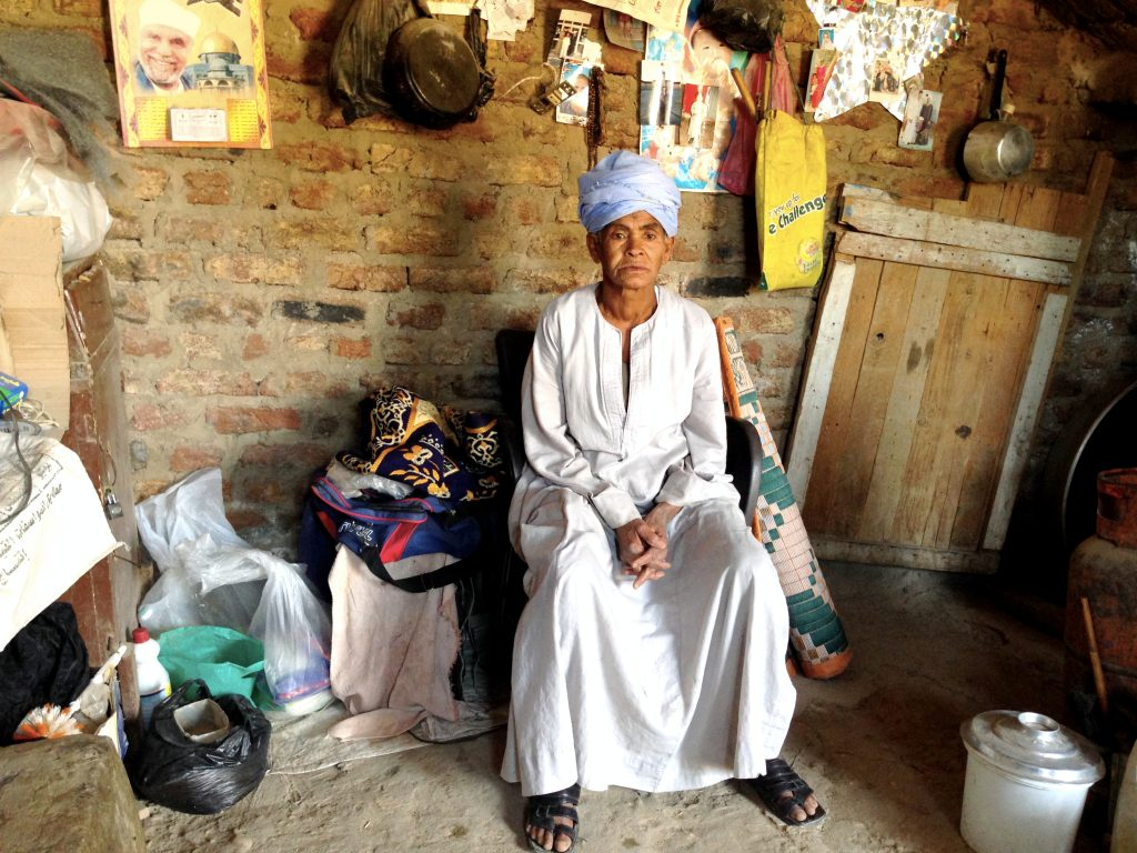 Sisa Abu Daooh at home. She spent the last 43 years dressed as a man to make ends meet for her and her daughter.