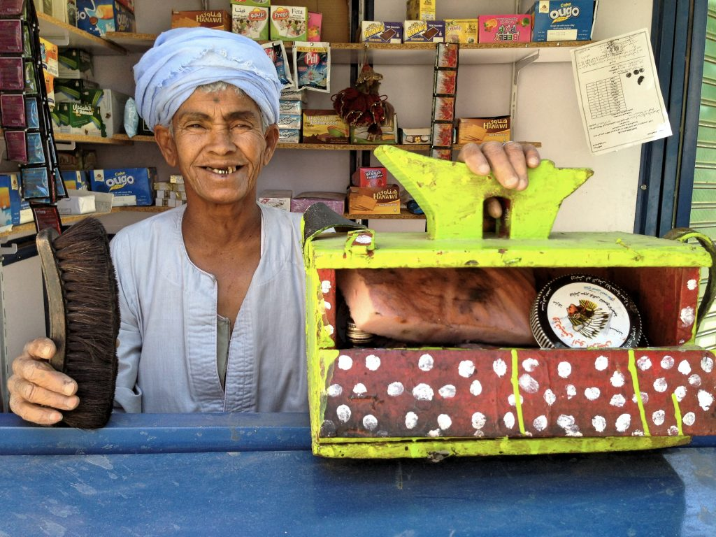 Although Daooh is proud of her kiosk, she keeps her shoe-shine box nearby, just in case.