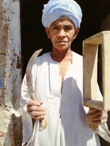 "Daooh's first job as a ""man"" was in making bricks, an exhaustive task. Later she harvested wheat, a less taxing job."