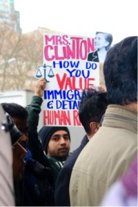 "DRUM member's sign asks, ""Mrs. Clinton, how do you value immigrant & detainee human rights?"""