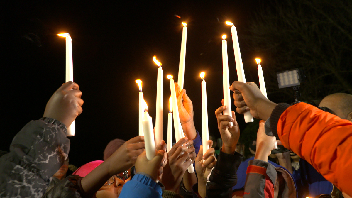 Children hold up candles at a vigil for victims of the San Bernardino shootings at the Silver Spring Muslim Community Center in Silver Spring, Maryland. >Photos courtesy of Jay Mallin