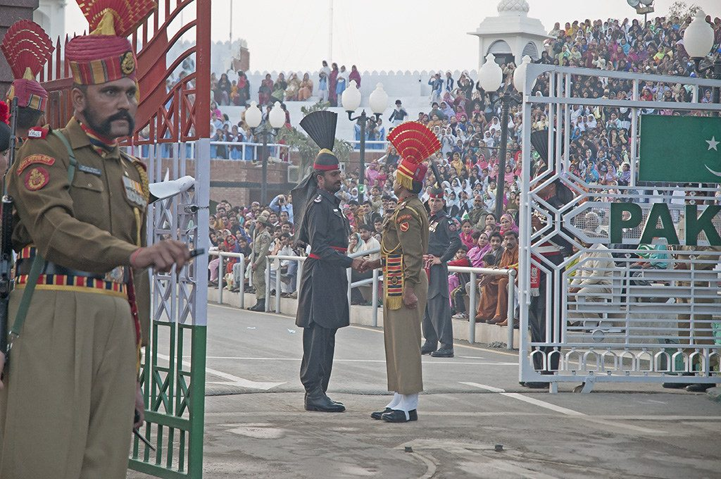 Flag ceremony on the Indian-Pakistani border >Flickr/Koshy Koshy