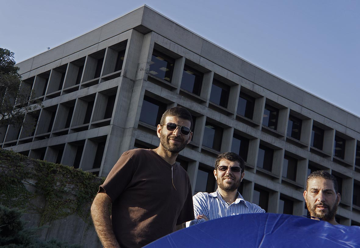 Ali, Omar and Adel in a protest camp out with the U.S. Embassy building behind them in Montevideo, Uruguay. >Photo courtesy of Oscar Bonilla