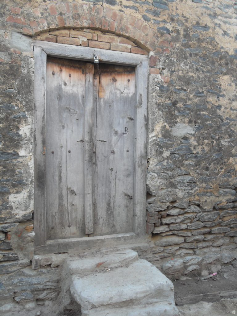 The doorway to the author's great-grandparents' home is the original door they used when they were alive.