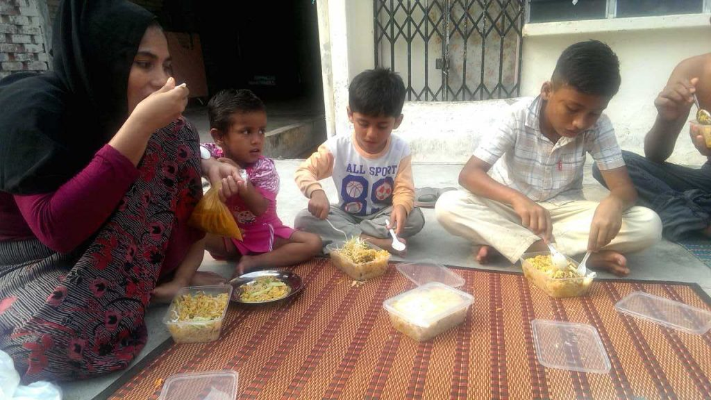 Dil Muhammad Rahman, Hasinah Izhar and their children share a meal together. Activist Mariam Mehter raised money for their family to help them through their hardship after a New York Times article was published detailing their journey to Malaysia.