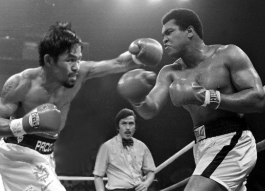 01 Oct 1975, Manila, Philippines --- Muhammad Ali Punching Joe