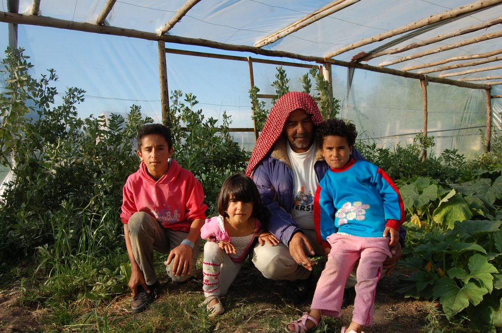Merhi Alshebli with some of his children at their home in Juan Lacaze. He has said that he would farm if he had more land. He has barely a hectare right now. >Taylor Barnes