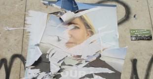 A torn up poster depicting Marine Le Pen, found in 2012. Photo Credit: Sylke Ibach Flickr Link: https://flic.kr/p/dBmjEG