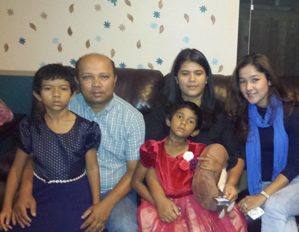 Zubair with his family and Wai Wai Nu in California.
