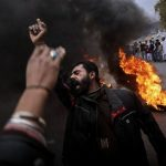 Protesters are burning tires and chanting slogans against attacks on worship places in Lahore, Pakistan. Photo Credit: Samar Abbas
