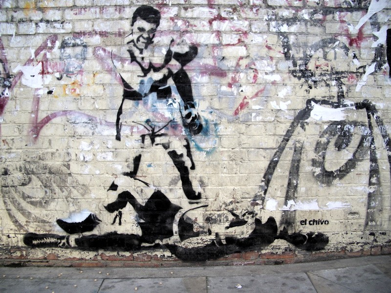 Photo Credit: Gingerbeardman on Flickr Photo Caption: A wall stencil of Muhammad Ali's victory over Sonny Liston Flickr Link: https://flic.kr/p/kMUJp