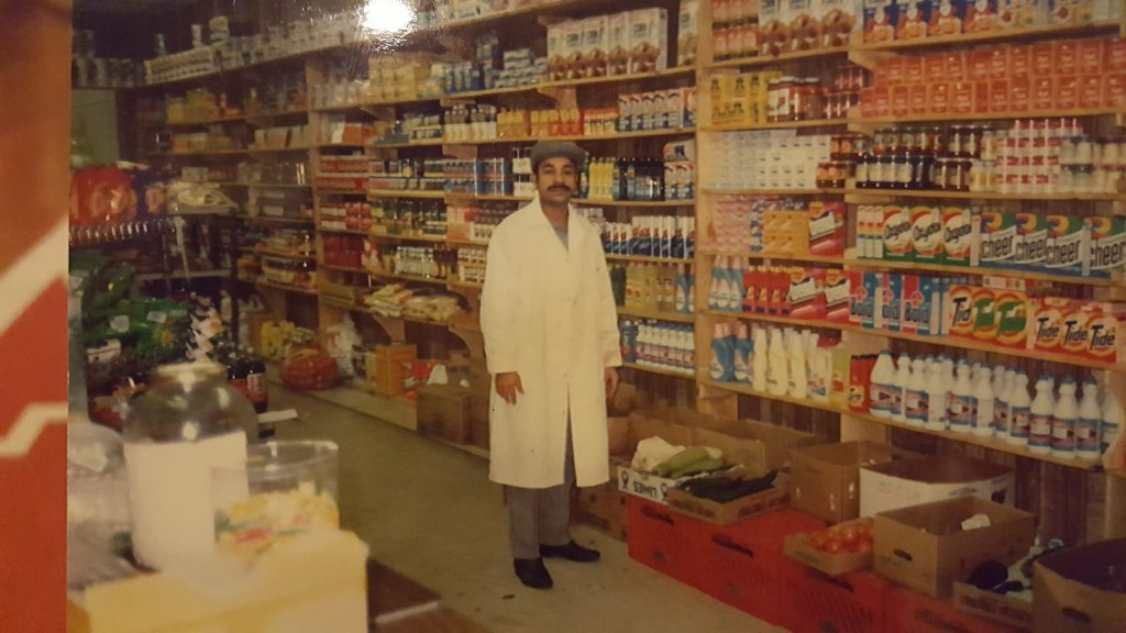 Adam Samad's father in the 1980s in his store Al-Amin in Queens, NY. Copyright Adam Samad