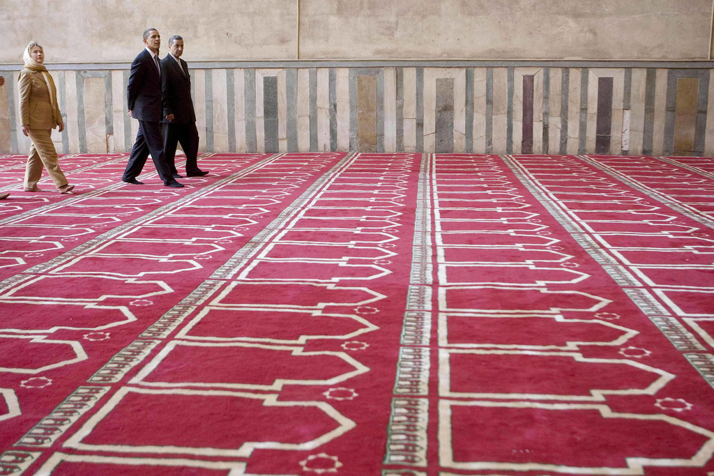 U.S. President Barack Obama and Hillary Clinton, when she was secretary of state, tour the Sultan Hassan Mosque in Cairo on June 4, 2009. >Flickr/Muhammad Ghafari/Reuters